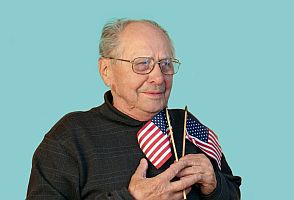 senior man with american flag isolated